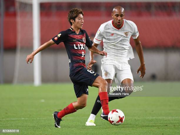 Shoma Doi of Kashima Antlers and Steven Nzonzi of Sevilla FC compete for the ball during the preseason friendly match between Kashima Antlers and...