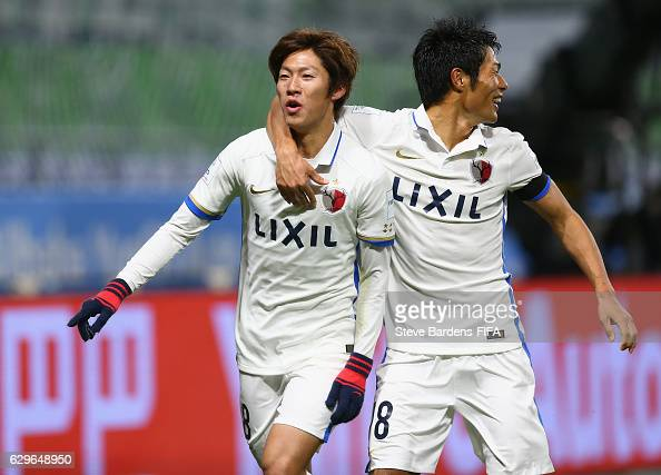 Shoma Doi of Kashima Antlers celebrates with Shuhei Akasaki after he scores his side's first goal from the penalty spot during the FIFA Club World...