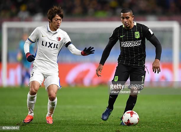Shoma Doi of Kashima Antlers closes down Farid Diaz of Atletico Nacional during the FIFA Club World Cup Semi Final match between Atletico Nacional...