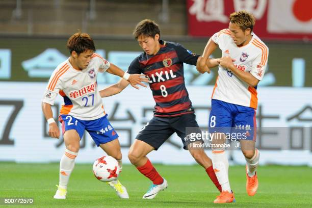 Shoma Doi of Kashima Antlers competes for the ball against Yuto Horigome and Kei Koizumi of Albirex Niigata during the JLeague J1 match between...