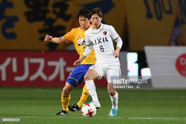 Shoma Doi of Kashima Antlers controls the ball under pressure of Naoki Ishikawa of Vegalta Sendai during the JLeague J1 match between Vegalta Sendai...