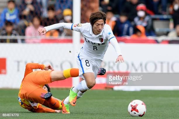 Shoma Doi of Kashima Antlers runs past Ryohei Shirasaki of Shimizu SPulse during the JLeague J1 match between Shimizu SPulse and Kashima Antlers at...