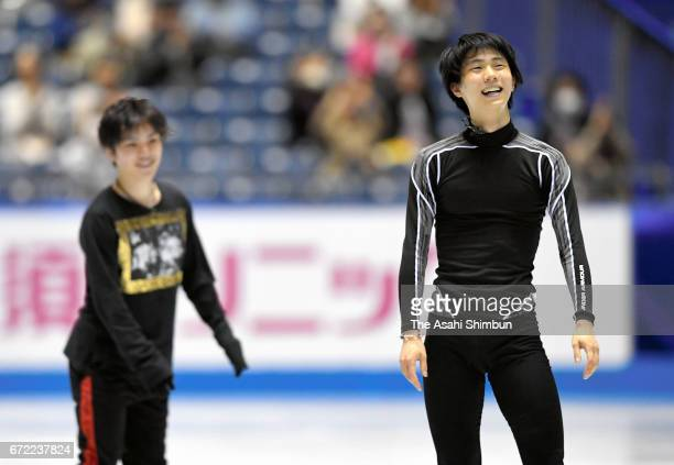 Shoma Uno and Yuzuru Hanyu of Japan look relaxed during a practice during day three of the ISU World Team Trophy at Yoyogi Nationala Gymnasium on...