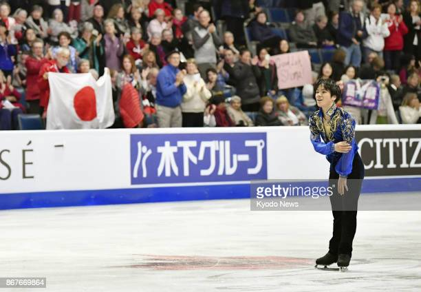 Shoma Uno of Japan acknowledges the crowd after performing in the men's singles free program at Skate Canada International at Brandt Center in Regina...