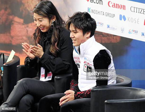 Shoma Uno of Japan celebrates his score with his coach Mihoko Higuchi at the kiss cry after competing in the Senior Men's Singles Free Skating during...