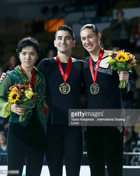 Shoma Uno of Japan Max Aaron of USA and Jason Brown of USA men on the free skate winner's podium on October 24 2015 in Milwaukee Wisconsin