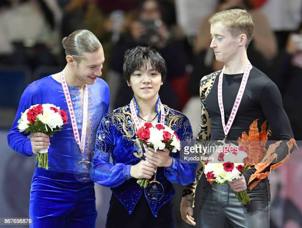 Shoma Uno of Japan poses for a photo on the podium after winning the Skate Canada International at Brandt Center in Regina Canada on Oct 28 alongside...