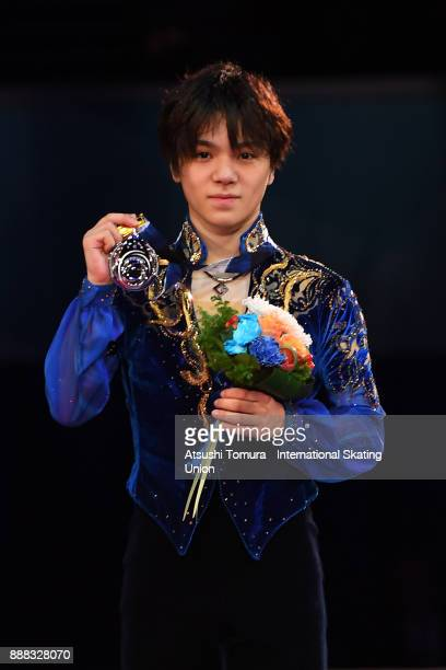 Shoma Uno of Japan poses on the podium after competing in the men free skating during the ISU Junior Senior Grand Prix of Figure Skating Final at...