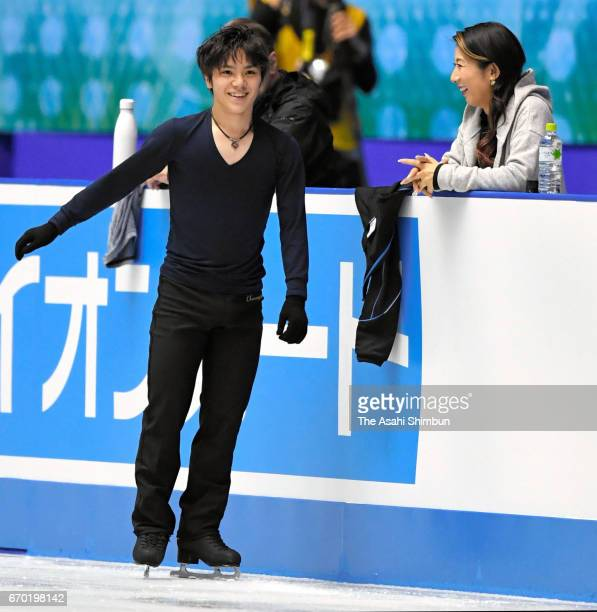 Shoma Uno of Japan talks with his coach Mihoko Higuchi during a practice session ahead of the ISU Team Trophy at Yoyogi National Gymnasium on April...