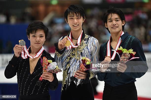 Shoma Uno of Japan Yuzuru Hanyu of Japan and Takahiko Kozuka of Japan pose in the award ceremony during the 83rd All Japan Figure Skating...