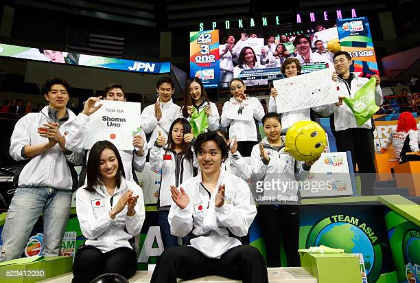 Shoma Uno of Team Asia celebrates with Captain Shizuka Arakawa and teammates after competing in the Men's Singles Short Program on day 1 of the KOSE...