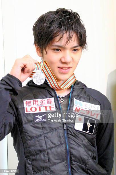 Shoma Uno shows his silver medal of the World Figure Skating Championships on arrival at Narita International Airport on April 4 2017 in Narita Chiba...