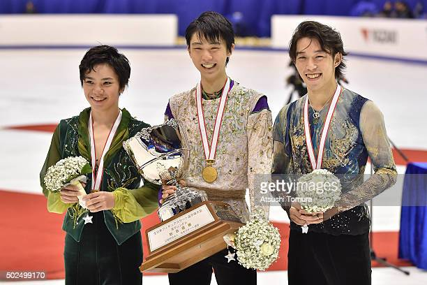 Shoma Uno Yuzuru Hanyu and Takahito Mura of Japan pose with their medals during the day two of the 2015 Japan Figure Skating Championships at the...
