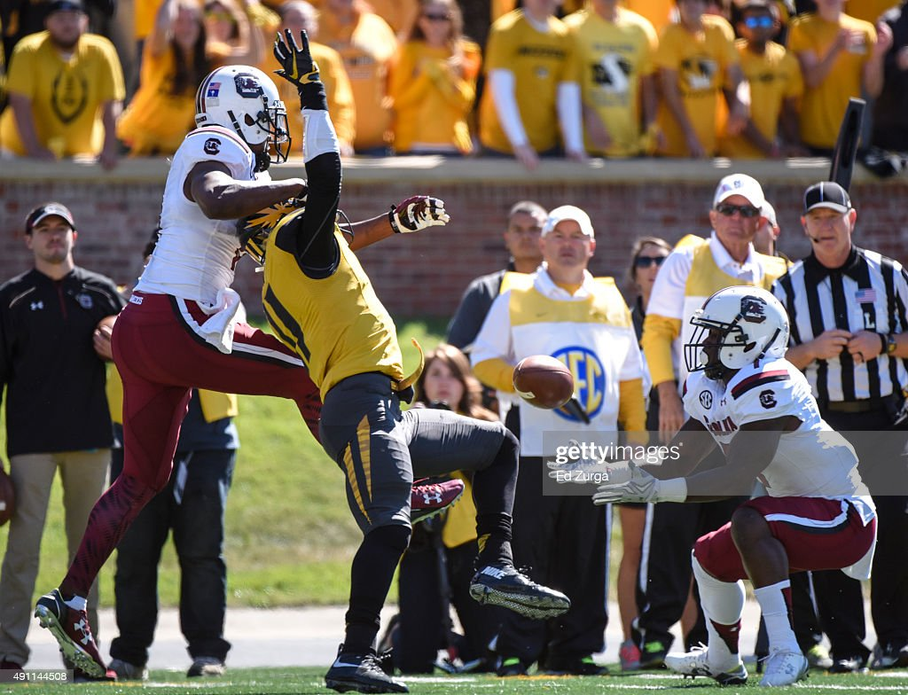 Shon Carson #7 of the South Carolina Gamecocks catches a deflected ball by Aarion Penton #11 of the Missouri Tigers that was intended for Pharoh Cooper #11 in the second quarter at Memorial Stadium on October 3, 2015 in Columbia, Missouri. Carson would run the ball in for a touchdown.