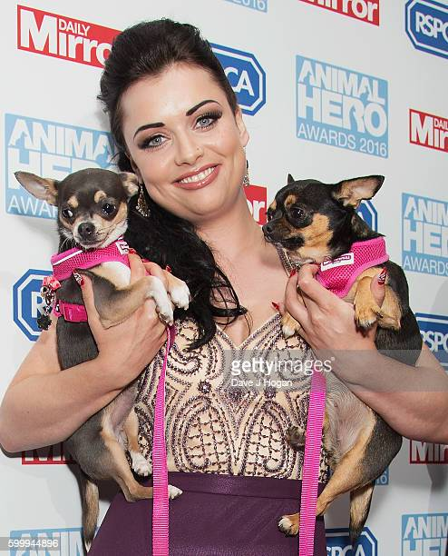 Shona McGarty arrives with her pet dogs for Daily Mirror and RSPCA Animal Hero Awards at Grosvenor House on September 7 2016 in London England