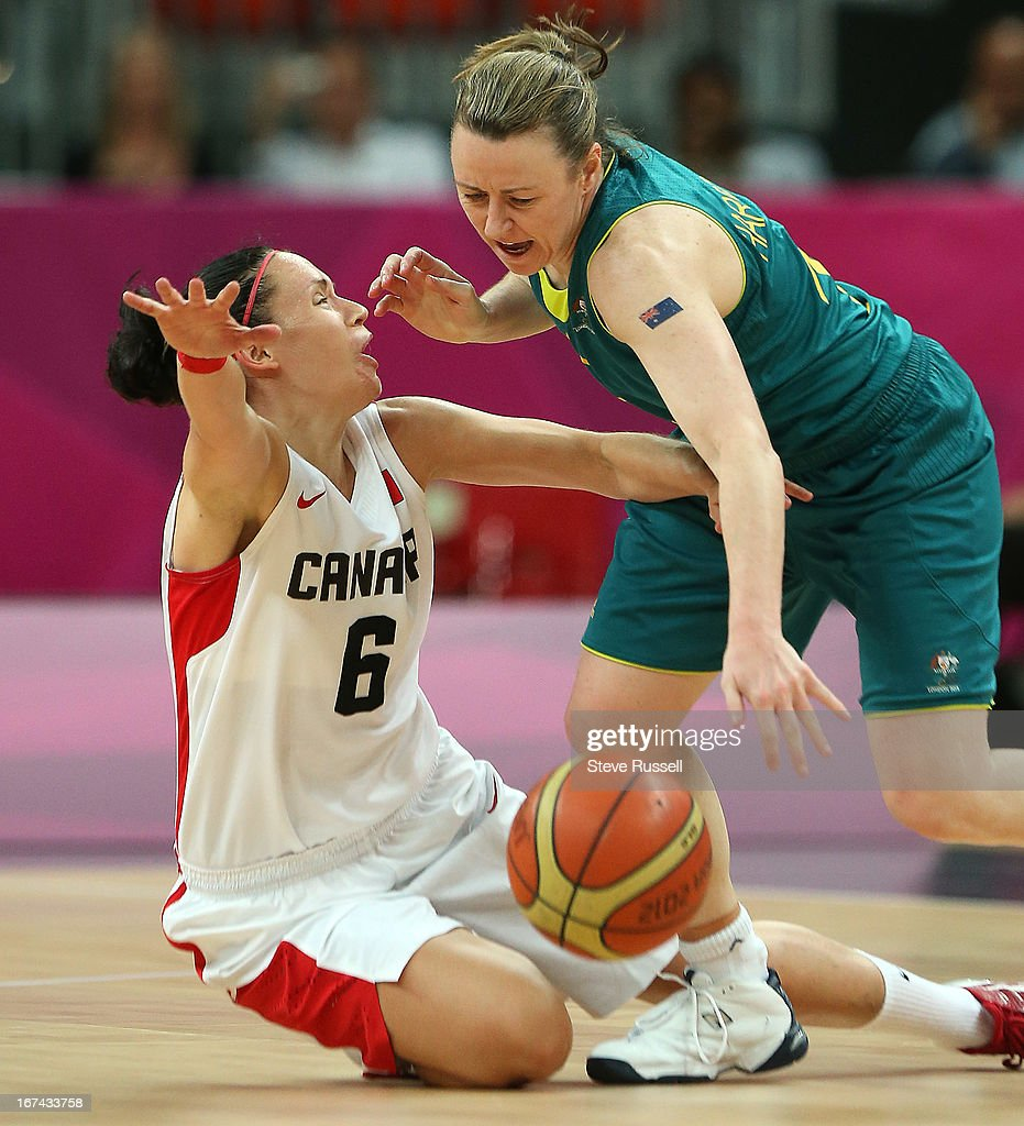 Shona Thorburn gets an arm to the face from Austraila's Kristi Harrower as Canada loses to Australia in the women's basketball tournament at the London 2012 Olympic Games at the Basketball Arena.