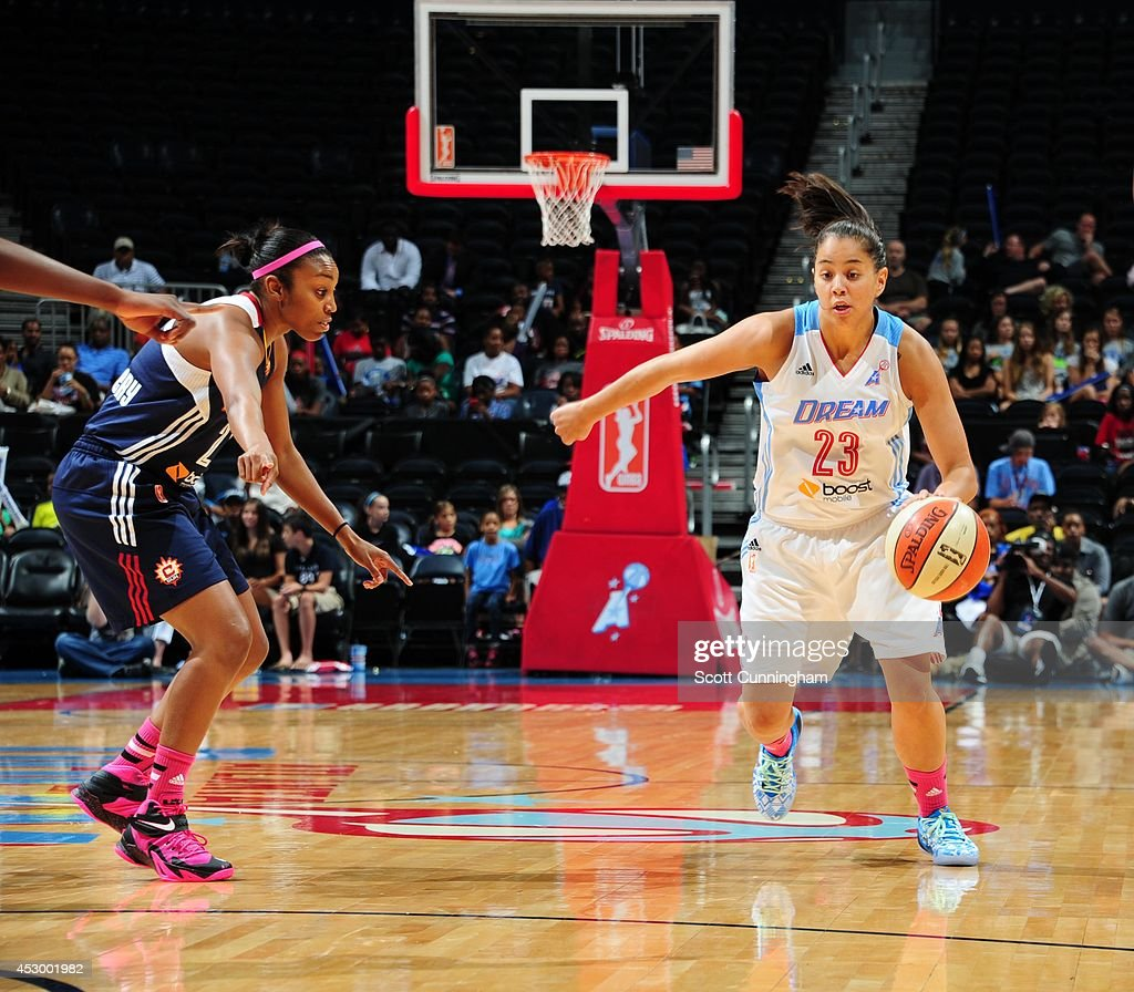 Shoni Schimmel #23 of the Atlanta Dream drives to the basket against Renee Montgomery #21 of the Connecticut Sun on July 29, 2014 at Philips Arena in Atlanta, Georgia.