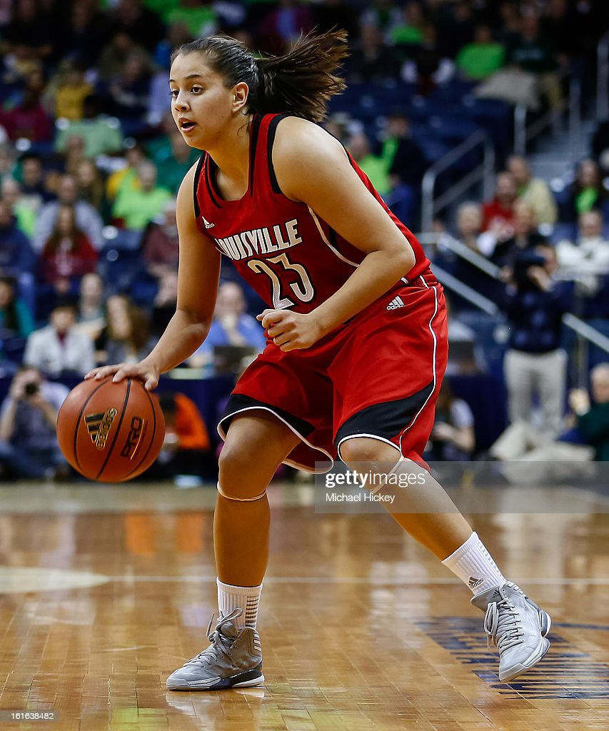 Shoni Schimmel #23 of the Louisville Cardinals dribbles the ball up court against the Notre Dame Fighting Irish at Purcel Pavilion on February 11, 2013 in South Bend, Indiana. Notre Dame defeated Louisville 93-64.