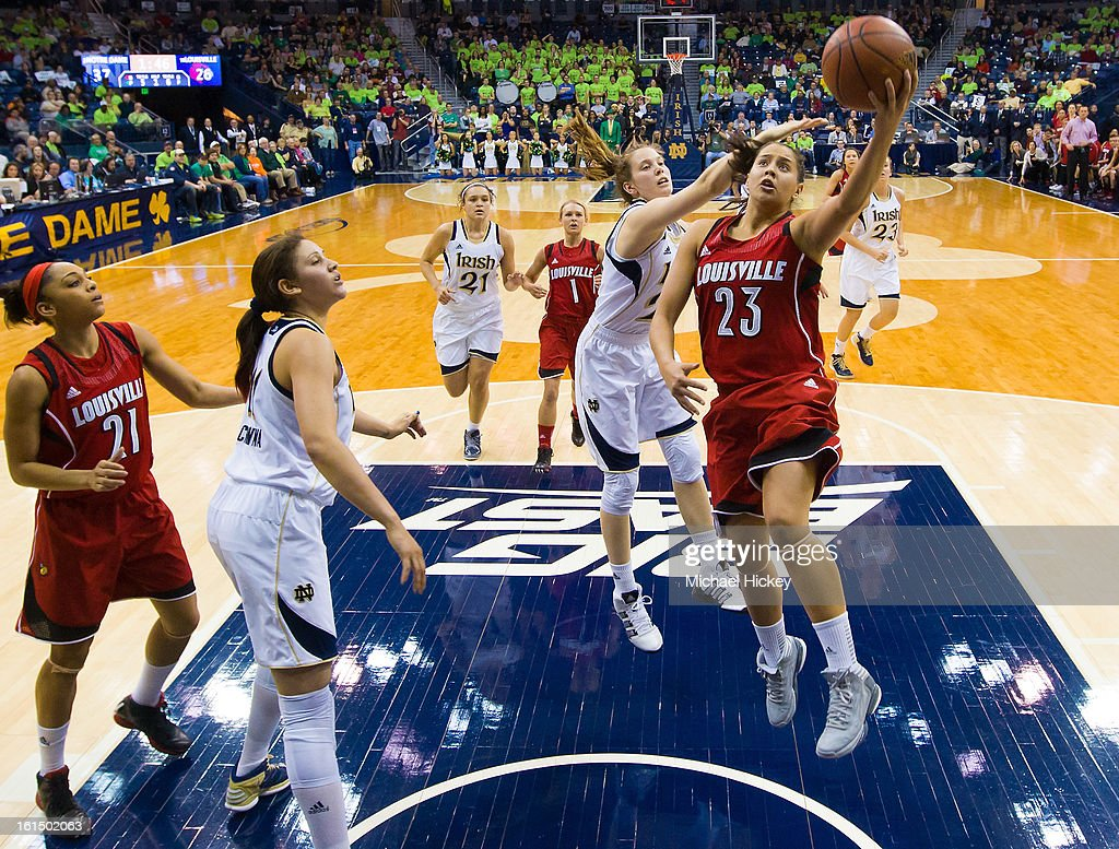 Shoni Schimmel #23 of the Louisville Cardinals shoots the ball as Michaela Mabrey #23 of the Notre Dame Fighting Irish defends from behind at Purcel Pavilion on February 11, 2013 in South Bend, Indiana. Notre Dame defeated Louisville 93-64.