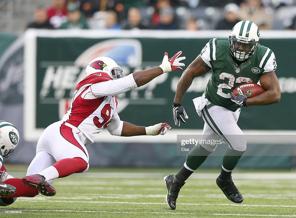 <a gi-track='captionPersonalityLinkClicked' href=/galleries/search?phrase=Shonn+Greene&family=editorial&specificpeople=3955669 ng-click='$event.stopPropagation()'>Shonn Greene</a> #23 of the New York Jets carries the ball as <a gi-track='captionPersonalityLinkClicked' href=/galleries/search?phrase=Sam+Acho&family=editorial&specificpeople=4510331 ng-click='$event.stopPropagation()'>Sam Acho</a> #94 of the Arizona Cardinals defends on December 2, 2012 at MetLife Stadium in East Rutherford, New Jersey. The New York Jets defeated the Arizona Cardinals 7-6.