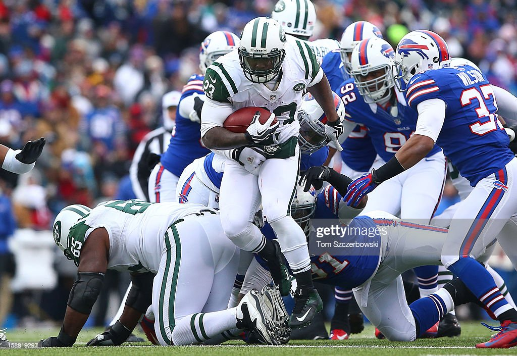 Shonn Greene #23 of the New York Jets carries the ball during an NFL game against the Buffalo Bills at Ralph Wilson Stadium on December 30, 2012 in Orchard Park, New York.