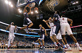 Shonn Miller of the Connecticut Huskies dunks during a semifinal game of the 2016 AAC Basketball Tournament against the France at Amway Center on...