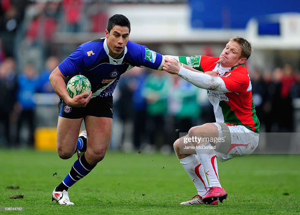 Shontayne Hape of Bath holds off Iain Balshaw of Biarritz during the Heineken Cup match between Biarritz and Bath at the Parc des Sports Aguilera on...