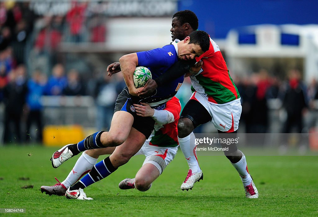 Shontayne Hape of Bath holds off Takudzwa Ngwenta of Biarritz during the Heineken Cup match between Biarritz and Bath at the Parc des Sports Aguilera...