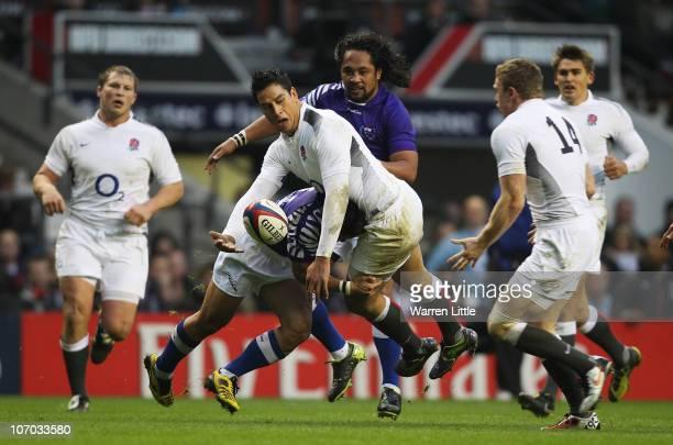 Shontayne Hape of England is tackled by David Lemi of Samoa during the Investec Challenge match between England and Samoa at Twickenham Stadium on...