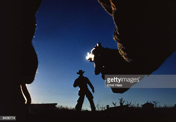 A shoot out between two cowboys in the Wild West shot during the filming of William Wyler's western 'The Big Country' a United Artist film Image...