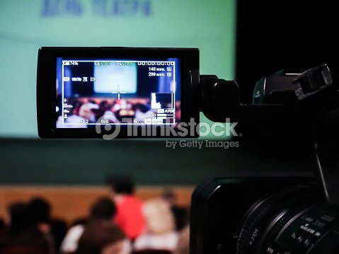 Shooting concert video. Control monitor. Blurred background, bokeh. Videography : Stock Photo