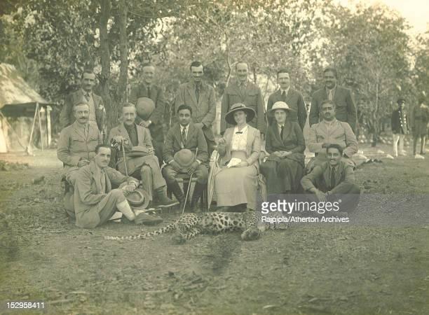 A shooting party led by Maharajah Vijayasinhji of Rajpipla poses with a dead leopard in the Satpura forest Rajpipla Gujarat India February 1917...