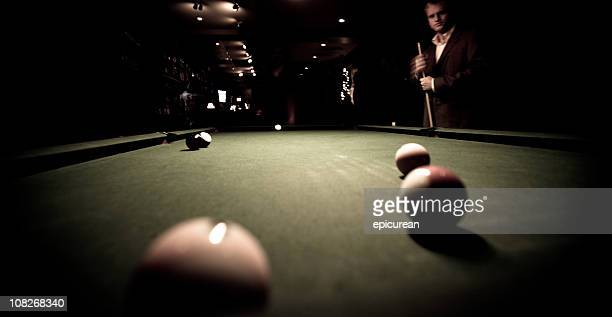 Shooting pool at a bar - contemplating next shot