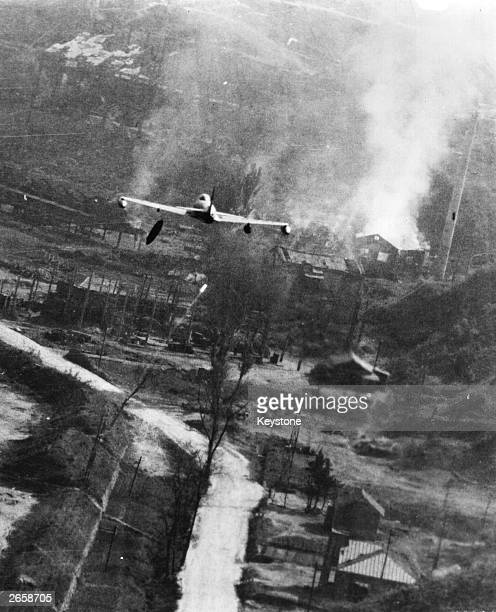 Shooting Star making a lowlevel attack with a napalm bomb on a storage centre at Suan southeast of P'yongyang during the Korean War