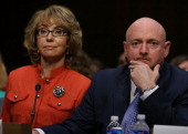Shooting survivor and former congresswoman Gabrielle Giffords is seated next to her husband Captain Mark Kelly USN during a Senate Judiciary...