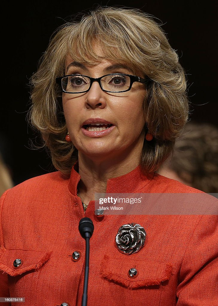 Shooting survivor and former congresswoman Gabrielle Giffords (D-AZ) (L) speaks during a Senate Judiciary Committee hearing on gun violence, January 30, 2013 in Washington, DC. The committee is hearing testimony on what can be done to curb gun violence in America.
