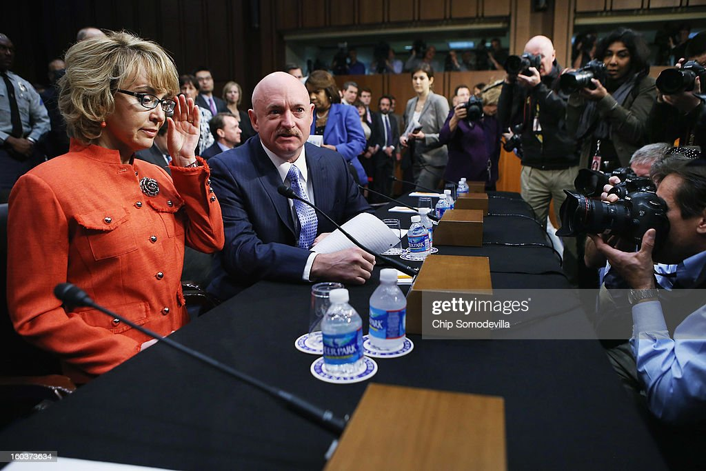 Shooting victim and former U.S. Rep. Gabby Giffords (D-AZ) (L) and her husband Retired NASA astronaut and Navy Capt. <a gi-track='captionPersonalityLinkClicked' href=/galleries/search?phrase=Mark+Kelly+-+Astronaut+and+Gun+Control+Advocate&family=editorial&specificpeople=566699 ng-click='$event.stopPropagation()'>Mark Kelly</a> (2nd L) arrive for a Senate Judiciary Committee hearing about gun control on Capitol Hill January 30, 2013 in Washington, DC. Giffords delivered an opening statment to the committee, which met for the first time since the mass shooting at a Sandy Hook Elementary School in Newtown, Connecticut.