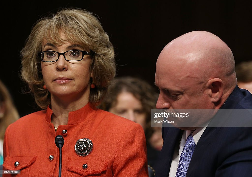Shooting victim and former U.S. Rep. Gabby Giffords (D-AZ) (L) and her husband Retired NASA astronaut and Navy Capt. Mark Kelly (2nd L) arrive for a Senate Judiciary Committee hearing about gun control on Capitol Hill January 30, 2013 in Washington, DC. Giffords delivered an opening statment to the committee, which met for the first time since the mass shooting at a Sandy Hook Elementary School in Newtown, Connecticut.