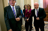 Shooting victim and former US Rep Gabby Giffords is escorted by US Sen Joe Manchin and her husband former NASA astronaut Mark Kelly while walking to...