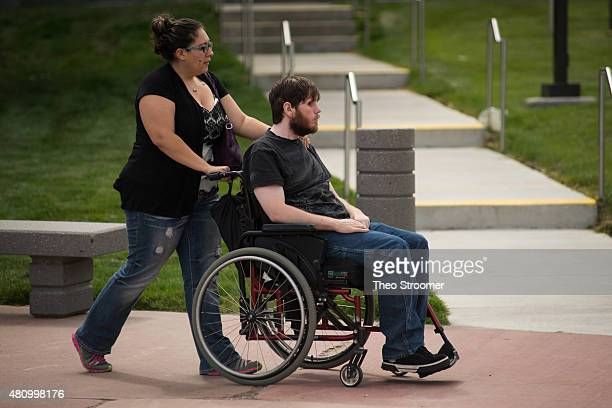 Shooting victim Caleb Medley arrives before a verdict was delivered in the trial of James Holmes at the Arapahoe County Justice Center on July 16...