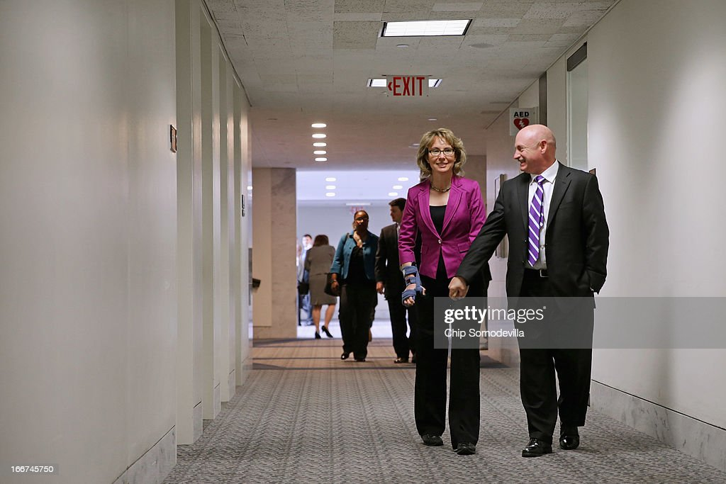 Shooting victim, former Rep. Gabrielle Giffords (D-AZ) (L) and her husband and retired astronaut Mark Kelly arrive for a meeting with senators in the Hart Senate Office Building on Capitol Hill April 16, 2013 in Washington, DC. Giffords and Kelly met with members of Congress, including Sen. Pat Toomey (R-PA) and Sen. Joe Manchin (D-WV), who have sponsored legislation to help curb gun violence.