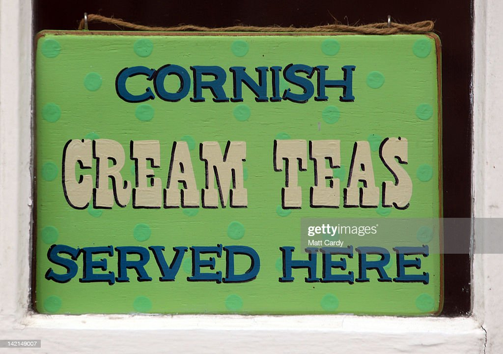A shop advertises Cornish cream teas in the window of a cafe in St Ives on March 30, 2012 in Cornwall, England. With only a few months to go until the opening ceremony of the London 2012 Olympic games, Britain's tourist industry is hoping to benefit from the influx of athletes, officials and visitors.