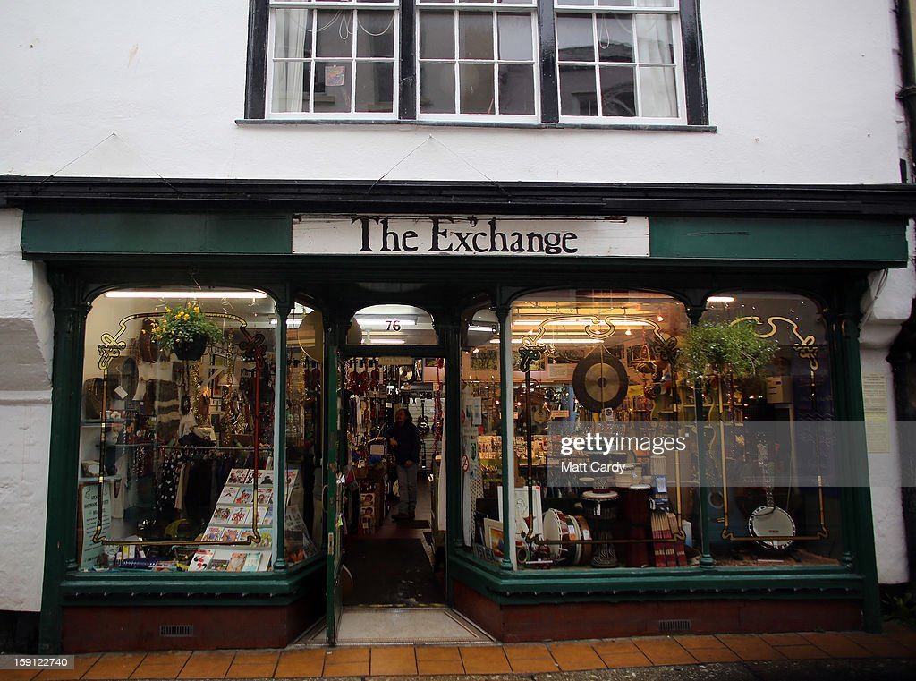 A shop along the main shopping street of Totnes is seen on January 8, 2013 in Totnes, England. The Devon town is renowned for its belief in promoting trade of local independent retailers, famously denying the plans by national coffee chain Costa to open a high street branch in the town. Boasting its own local currency, Totnes has a shop vacancy rate of 6%, less than half than the national average, whilst 80% of outlets are independently owned.