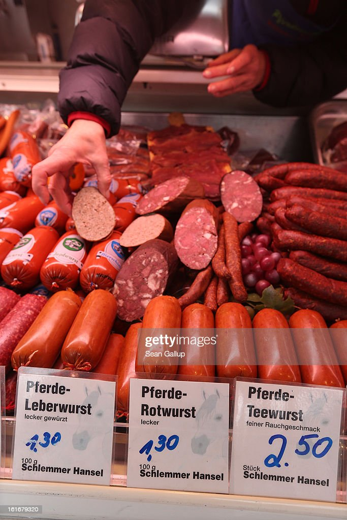 A shop assistant arranges horsemeat ham, wurst and sausage at the Schlemmer Hansel stand at the weekly open-air market in Hohenschoenhausen district on February 14, 2013 in Berlin, Germany. While authorites arcoss Europe investigate the origin of ready-made lasagne that was labeled to contain only beef when it in fact also contained horsemeat, fans of horsemeat are pointing to its good taste and its health benefits. Horsemeat contains significantly less fat than beef and has slightly higher protein.