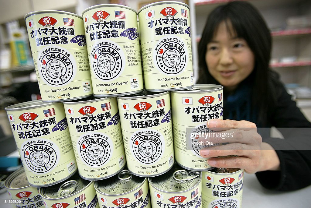 Shop assistant Chika Shimada displays the limited canned bread with the commemorable label for the inauguration of US Presidentelect Barack Obama at...