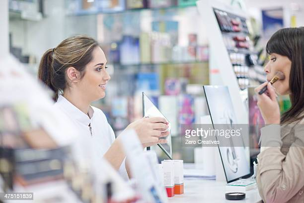 Shop assistant doing make up demonstration