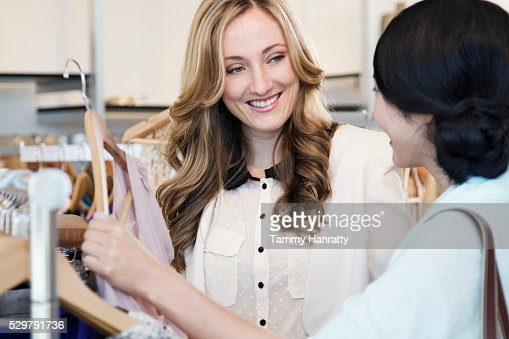 Shop assistant helping with choosing product : Stock-Foto