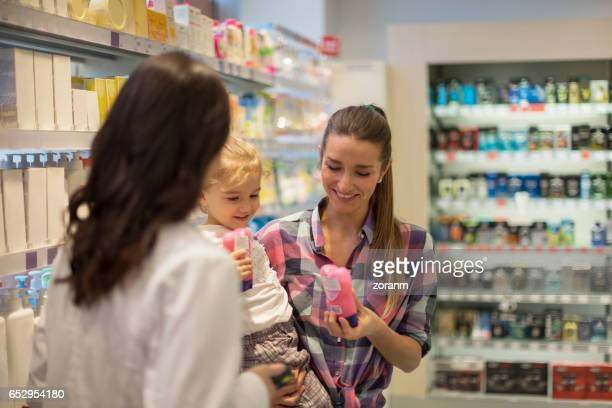 Shop assistant helps customers