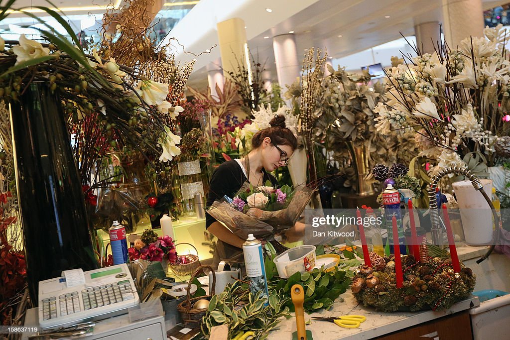 A shop assistant prepares flowers in Westfield Shopping centre in West London on December 22, 2012 in London, England. Today is the final Saturday before Christmas.