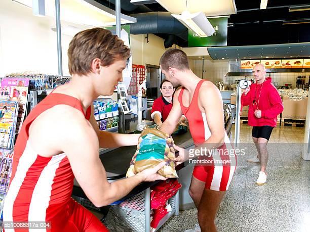 Shop assistant serving customers